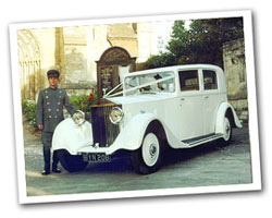 1934 vintage Rolls Royce wedding car in white